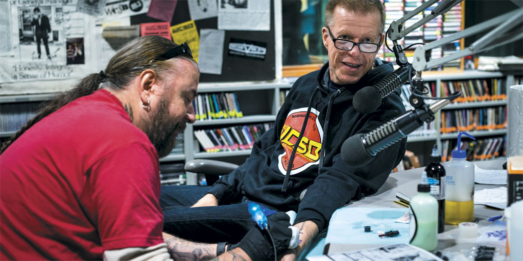 Derek Hess getting a tattoo